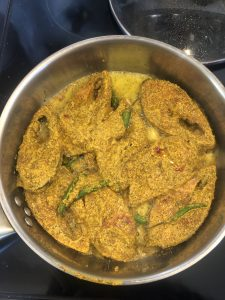 Shorshe Ilish being cooked on Stove top